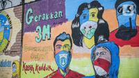 Lukisan mural melawan virus corona COVID-19 di Kawasan Cikokol, Cawang, Jakarta, Minggu (4/10/2020).  Mural masih dianggap menjadi sarana edukasi kesehatan yang tepat bagi warga untuk menjaga diri dari penularan virus Covid 19. (Liputan6.com/Faizal Fanani)