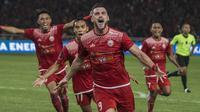 Striker Persija Jakarta, Marko Simic, melakukan selebrasi usai mencetak gol ke gawang  Bali United pada final Piala Presiden di SUGBK, Jakarta, Sabtu (17/2/2018). Persija menang 3-0 atas Bali United. (Bola.com/M Iqbal Ichsan)