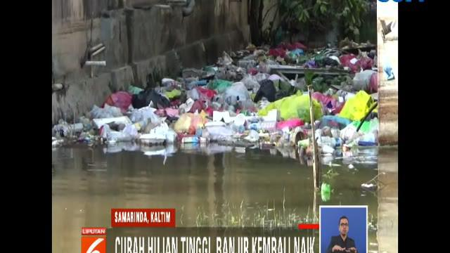Curah hujan yang tinggi ditambah pasang air laut diduga menjadi penyebab banjir tak kunjung surut.