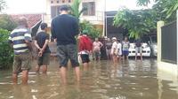 Banjir di Perumahan Kuda Mas Bekasi Sudah ke 4 kali terjadi. (Liputan6.com/Bam Sinulingga)