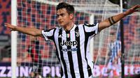 Penyerang Juventus, Paulo Dybala, melakukan selebrasi usai mencetak gol ke gawang Bologna pada laga Liga Italia di Stadion Renato-Dall'Ara, Minggu (23/5/2021). Juventus menang dengan skor 4-1. (AFP/Andreas Solaro)