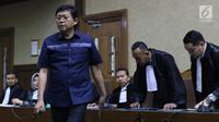 Advokat Lucas saat menjalani sidang dakwaan di Pengadilan Tipikor, Jakarta, Rabu (7/11). Lucas didakwa menghalangi proses penyidikan KPK terhadap tersangka mantan petinggi Lippo Group, Eddy Sindoro. (Liputan6.com/Helmi Fithriansyah)