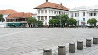 Suasana kawasan wisata Kota Tua yang sepi dari aktivitas di Jakarta, Selasa (26/5/2020). Adanya program PSBB menyebabkan kawasan yang biasanya selalu ramai saat libur tersebut menjadi sepi dari pengunjung di hari kedua pascalebaran. (Liputan6.com/Immanuel Antonius)