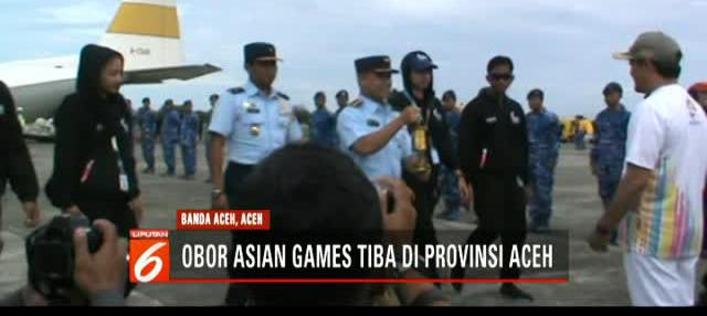 Kirab obor Asian Games 2018 telah tiba di Banda Aceh. Api singgah di Museum Tsunami dan Masjid Baiturrahman.