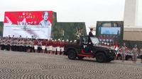 Presiden Joko Widodo atau Jokowi memimpin apel di Monas. (Liputan6.com/Hanz Jimenez Salim)