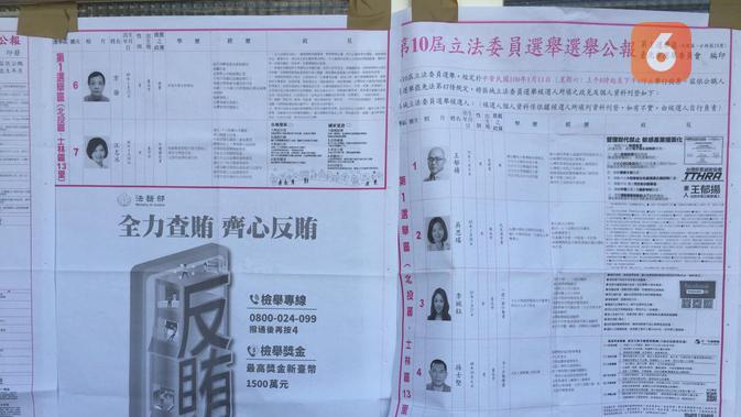 Informasi mengenai calon anggota legislatif yang dipasang di depan tempat pemungutan suara di Beitou Elementry School (Teddy Tri Setio Berty)