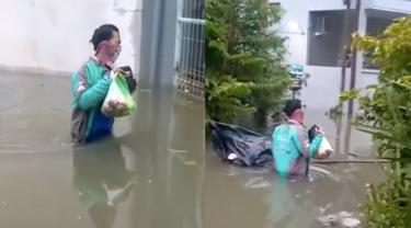Meski Sedang Banjir Driver Ojol Ini Tetap Semangat Antar Pesanan, Bikin Salut