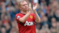 3. Paul Scholes - Lulusan dari akademi Manchester United yang dijuluki 'Class of 92' ini sempat pensiun pada Juli 2011. Hanya berselang enam bulan, gelandang kreatif ini diminta kembali memperkuat Setan Merah. (AFP/Andrew Yates)