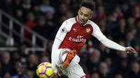 Pemain anyar Arsenal, Pierre-Emerick Aubameyang menerima gaji per minggu sebesar 180.000 pound sterling dengan durasi kontrak hingga 2022. (AP/Alastair Grant)