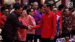 Presiden Joko Widodo atau Jokowi saat menghadiri HUT ke-46 PDIP di JIExpo Kemayoran, Jakarta, Kamis (10/1). Jokowi berpesan kepada para kader PDIP untuk bergotong royong memperkuat persatuan Indonesia. (Liputan6.com/JohanTallo)