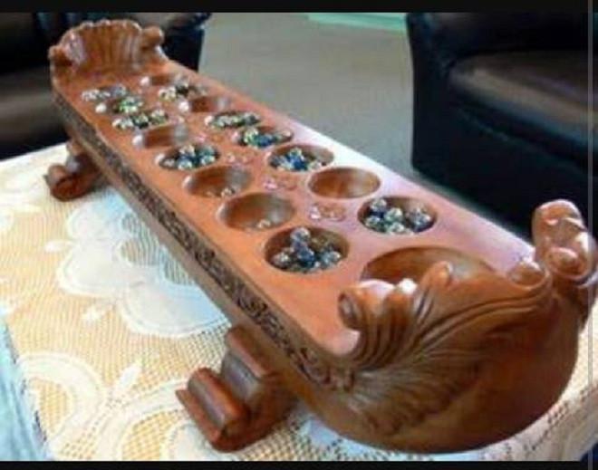 Permainan Congklak. (Liputan6.com/Jayadi Supriadin).
