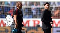 Ekspersi pelatih AC Milan, Vincenzo Montella usai pertandingan melawan Sampdoria pada lanjutan Liga Serie A Italia di Stadion Luigi Ferraris di Genoa (24/9). AC Milan takluk dari Sampdoria dengan skor 2-0.  (AFP Photo/Filippo Monteforte)