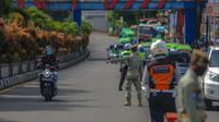 Pemkot Bogor memberlakukan kebijakan ganjil genap setiap akhir pekan untuk membatasi mobilitas warga di tengah pandemi Covid-19. (Liputan6.com/Achmad Sudarno)