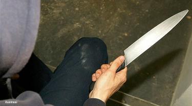 Ilustrasi pria besenjata pisau.