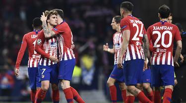 Selebrasi pemain Atl Madrid usai Diego Godin mencetak gol pada leg 1, babak 16 besar Liga Champions yang berlangsung di stadion Wanda Metropolitano, Madrid., Kamis (21/2). Atl Madrid menang 2-0 atas Juventus (Javier Soriano)