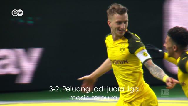 Berita video DW Matchday Moments menghadirkan Marco Reus yang berhasil mencetak gol ke gawang Hertha Berlin. Torehannya tersebut membuat Borussia Dortmund masih bersaing dengan Bayern Munchen untuk gelar juara Bundesliga 2018-2019.