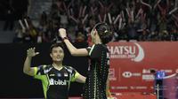 Pebulutangkis Indonesia, Hafiz Faizal / Gloria Widjaja, merayakan kemenangan atas pasangan Malaysia pada Indonesia Masters 2019 di Istora Senayan, Jakarta, Selasa (22/1). Hafiz / Gloria lolos ke babak kedua. (Bola.com/M. Iqbal Ichsan)