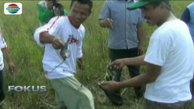 Dalam rangka memeriahkan HUT Kemerdekaan Republik Indonesia ke-72, warga Desa Pudai, Sulawesi Tenggara, menggelar lomba balap tikus.