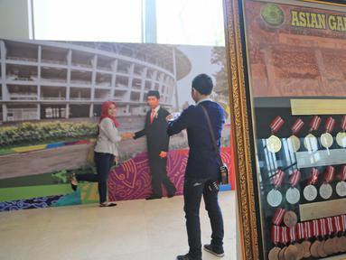 Koleksi sejarah Asian Games 1962, di mana Indonesia menjadi tuan rumah untuk pertama kalinya, di Museum Nasional, Jakarta, Minggu (19/8). Pameran ini berlangsung selama 10 hari dimulai dari tanggal 18 hingga 28 Agustus 2018. (Liputan6.com/Herman Zakharia)
