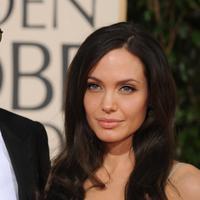 Kate Middleton sendiri menyarankan, jika Angelina Jolie bisa memaafkan Brad Pitt, ada baiknya mereka kembali bersama. (Robyn Beck AFP)