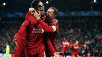 Georginio Wijnaldum merayakan gol keduanya. Liverpool dipastikan lolos ke final Liga Champions usai menang 4-0 atas Barcelona di Stadion Anfleld, Rabu (8/5/2019) dini hari. (AP/ Peter Byrne