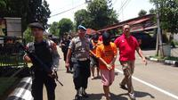 Wanita Bertato Hello Kitty dibunuh oleh Sopir Taksi Online. (Liputan6.com/Achmad Sudarno)