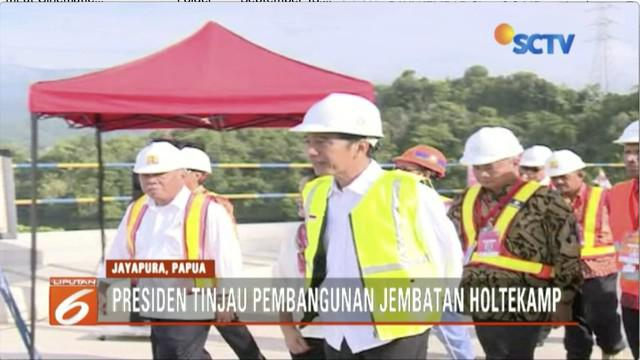 Jokowi meninjau perkembangan pembangunan Jembatan Holtekamp di Jayapura, jembatan sepanjang 732 meter  ini sudah 80 persen selesai dikerjakan.
