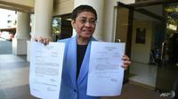 Wartawan terkemuka Filipina Maria Ressa mengatakan dia bisa dipenjara hingga tujuh tahun. (AFP / Ted ALJIBE)