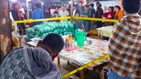 Garis polisi terpasang di lokasi perampokan dan penembakan pedagang pasar induk Pekanbaru.  (Liputan6.com/Istimewa)