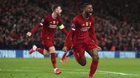 Gelandang Liverpool, Georginio Wijnaldum berselebrasi usai mencetak gol ke gawang Atletico Madrid pada pertandingan leg kedua babak 16 besar Liga Champions di di stadion Anfield, Inggris (12/3/2020). Atletico menang atas 3-2 atas Liverpool dengan agregat 4-2. (Peter Byrne/PA via AP)