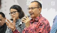 Ketua Satgas Waspada Investasi Tongam L Tobing menjelaskan tentang fintech di Indonesia, Jakarta, Rabu (12/12). Sedangkang P2P ilegal tidak menjadi tanggung jawab pihak manapun. (Liputan6.com/Angga Yuniar)
