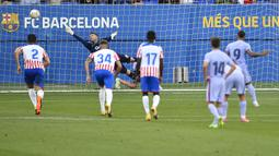 Tiga gol Barcelona dicetak oleh Gerard Pique (menit ke-21), Rey Manaj (24) dan sang pemain anyar, Memphis Depay (85). Sementara satu gol hiburan dari Girona dicetak oleh Samuel Saiz pada menit ke-42. (Foto: AFP/Pau Barrena)