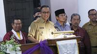 Gubernur DKI Jakarta Anies Baswedan memberi sambutan di malam Natal di Gereja Katedral Jakarta.