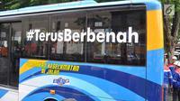"""Sebuah bus usai mengisi Bahan Bakar Gas (BBG) saat  launching """"Program Konventer Gas BRT Trans Semarang"""" di Pelataran Parkir Patra Jasa Semarang, Rabu (9/1). Sejumlah bus mulai beralih menggunakan BBG pada bus sedang (medium) . (Liputan6.com/Gholib)"""