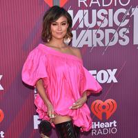 Penyanyi Agnez Mo berpose saat menghadiri iHeartRadio Music Awards 2019 di Los Angeles, California, AS, Kamis (14/3). Agnez Mo berhasil menyabet gelar juara kategori Social Star Award. (CHRIS DELMAS/AFP)