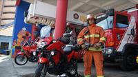 Dinas Pemadam Kebakaran (PMK) Kota Surabaya kini memiliki lima unit sepeda motor khusus. (Foto: Liputan6.com/Dian Kurniawan)