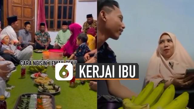 Sang ibu kaget dan tersenyum malu karena aksi jahil sang anak di hadapan keluarga.