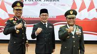 Gubernur Jawa Barat (Jabar) Ridwan Kamil saat menghadiri upacara Hari Bhayangkara ke-74 bersama Presiden RI via video conference di Mapolda Jabar, Kota Bandung, Rabu (1/7/20). (Foto: Humas Jabar)
