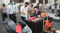 Polisi di Surabaya menangkap pelaku jambret ibu dan anak. Polisi juga menindak tegas pelaku dengan memberikan timah panas. (Foto: Dok Istimewa)