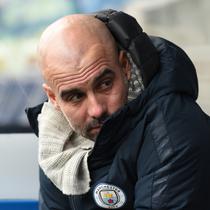 Pep Guardiola merasa Manchester City tampil buruk pada laga lanjutan Premier League yang berlangsung di stadion John Smith, Huddersfield, Minggu (20/1). Manchester City menang 3-0 atas Huddersfield. (AFP/Paul Ellis)