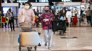 FOTO: Libur Panjang, Bandara Soetta Dipenuhi Penumpang