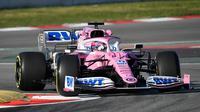 Pembalap Racing Point Sergio Perez saat tes pramusim Formula 1 (F1) hari pertama di Circuit de Catalunya, Montmelo, Spanyol, Rabu (19/2/2020). Sergio Perez menempati peringkat ketiga dengan waktu 1 menit 17,375 detik. (GEN LLUIS/AFP)