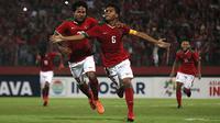 Selebrasi kapten Timnas Indonesia U-16, David Maulana, seusai menjebol gawang Filipina di penyisihan Grup A Piala AFF U-16 2018 di Stadion Gelora Delta, Sidoarjo (29/7/2018). (Bola.com/Aditya Wany)