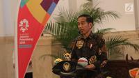 Presiden Joko Widodo memberi sambutan saat promosi Asian Games 2018, Jakarta, Selasa (5/6). Jokowi mengatakan yang kita inginkan sekarang ini mestinya masyarakat sudah demam. Nah ini baru anget. Belum panas apalagi demam. (Liputan6.com/Angga Yuniar)