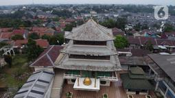 Foto aerial Masjid Jami Tan Kok Liong di Kampung Bulak Rata, Cibinong, Kab Bogor, Senin (4/5/2020). Masjid yang memiliki arsitektur seperti kelenteng tersebut dibangun pada 2005 lalu berdasarkan nama kecil sang pendiri yaitu M Ramdhan Effendi atau Anton Medan. (Liputan6.com/Helmi Fithriansyah)