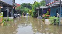 Perumahan Kenari De'Residence di Cimanggis, Depok banjir akibat tanggul kali Cipinang Jebol. (Foto: Dicky Agung/Liputan6.com).