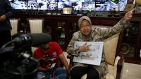Wali Kota Risma carikan saudara korban gempa Palu (Liputan6.com/Dian Kurniawan)