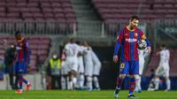 Barcelona menelan dua kekalahan di kandang sendiri secara beruntun. Sebelum dihajar PSG, Lionel Messi dkk lebih dulu dilumat Juventus 0-3 pada fase grup. (AP/Joan Monfort)