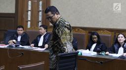 Terdakwa korupsi pengadaan dan pelaksanaan pembangunan kampus IPDN Sumbar di Kab Agam TA 2011, Dudy Jocom jelang menjalani sidang lanjutan di Pengadilan Tipikor Jakarta, Rabu (5/9). Sidang mendengar keterangan saksi. (Liputan6.com/Helmi Fithriansyah)