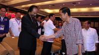 Capres Jokowi yang diusung koalisi PDIP, Nasdem, PBK, Hanura, dan PKP tampak ikut menghadiri   Rakernas Partai Nasdem (Liputan6.com/JohanTallo)